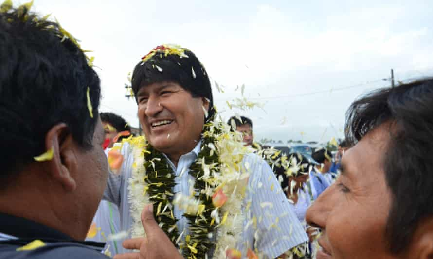 Bolivian President Evo Morales greets people as they arrive to vote in the referendum on constitutional reform.