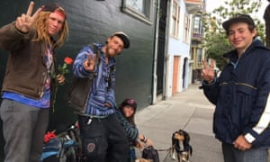 Isaiah Wolfe, aka Orange, second from left, and Sunshine Autrey, right, in Haight-Ashbury.