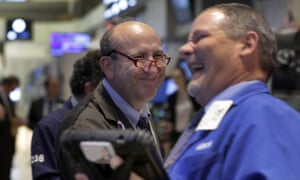 Andrew Silverman, left, and a fellow trader work on the floor of the New York Stock Exchange tonight.