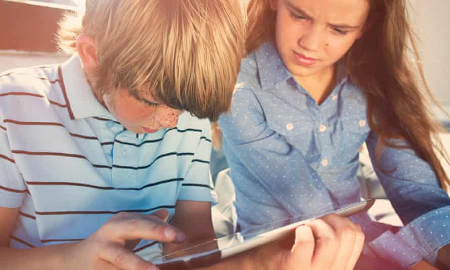 Brilliance for all ... a boy and girl reading a digital tablet