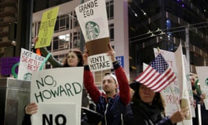 People protest outside before former Starbucks CEO Howard Schultz speaks during his book tour in Seattle, Washington, on 31 January.