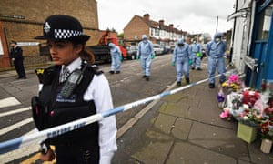Forensic officers search Chalgrove Road in Tottenham, north London, where a 17-year-old girl died after she was shot on 2 April.