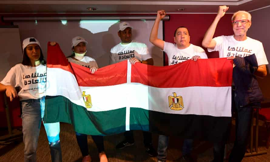 Egyptian representatives wave their national flag as they celebrate Tuesday's decision to choose the north Africa nations to replace Cameroon as hosts of the 2019 Africa Cup of Nations.