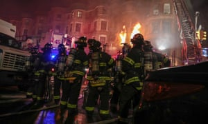 Firefighters tackle a blaze Fire on the Motherless Brooklyn film set in Harlem, New York City.