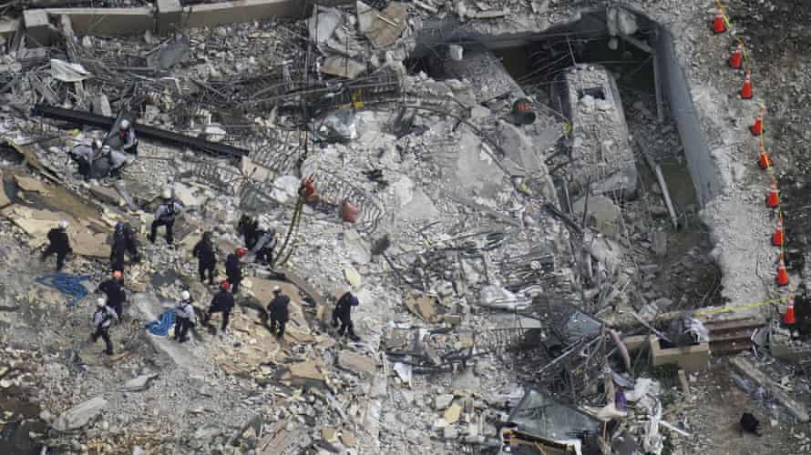 Rescue workers search in the rubble at the Champlain Towers South.