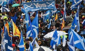 Protesters with Scottish Saltire flags attend the march organised by All Under One Banner calling for Scottish independence in Glasgow.