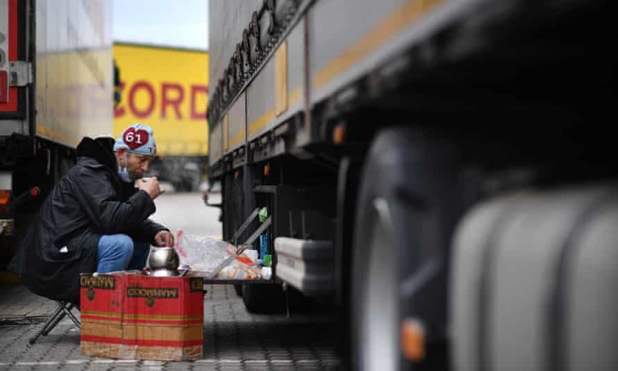 A Turkish driver drinks tea next to his truck at the a freight clearance centre following delays at the port of Dover.