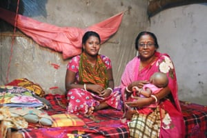 Kamona Sordar, 21, with her baby Boishakhi, born in April, with her midwife, Kolpona Saha, in Chalna Bazar, Khulna, southern Bangladesh