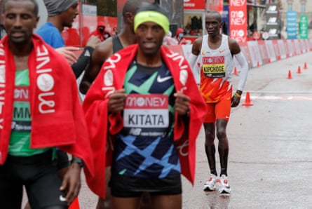 Kipchoge finishes behind the men's winners.