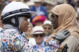 Khadijah Mellah, 18, from Peckham celebrates with her mother Selma after winning with her horse Haverland in the Magnolia Cup at Goodwood.