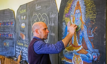 Steiner teacher writing on blackboard