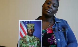 April Pipkins holds a photograph of her deceased son, Emantic Bradford Jr., during an interview in Birmingham on 27 November.