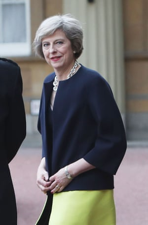 Theresa May leaves Buckingham Palace after an audience with the queen.