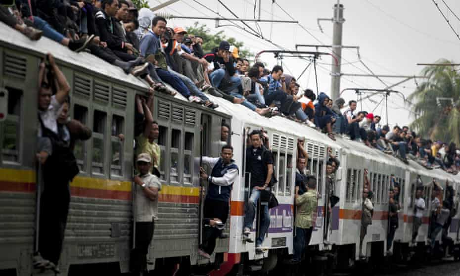 Commuters on the roof of train in Cawang, East Jakarta, in 2012. A crackdown has since stopped passengers roof riding and hanging from doors.