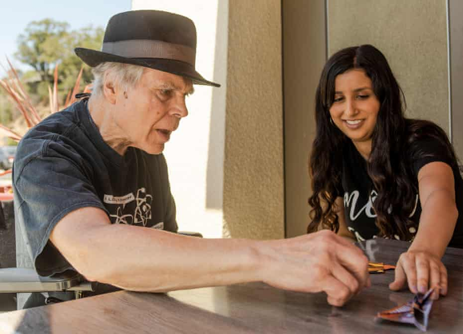 Tanya Tannous, right, visits with Ted Bunding at a coffee shop in Oakland, California.