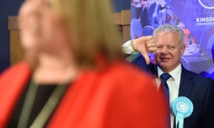 Brexit party candidate Mike Greene gives a thumbs down as Lisa Forbes gives her winner's speech