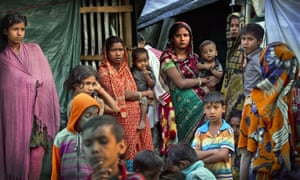 Rohingya Hindu refugees stand outside their make shift shelters at a refugee camp near Cox's bazar, Bangladesh.