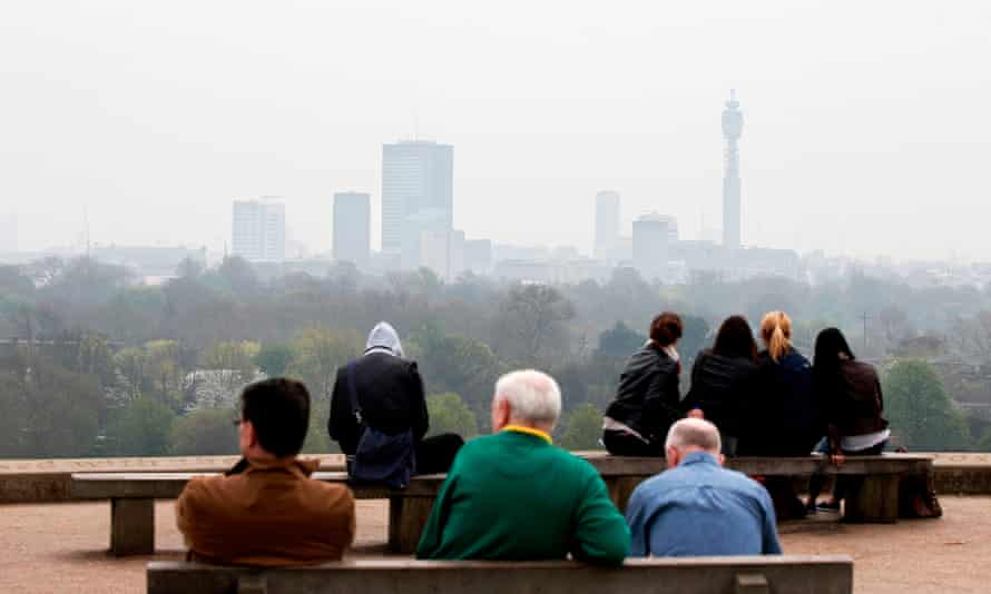 The view at the top of Primrose Hill in London, as the city below lies shrouded in pollution.
