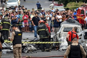 Belo Horizonte, BrazilFiremen and emergency personnel work at a site of a plane crash. According to reports, at least three people died and other three are injured after a small plane has crashed just after take-off over some vehicles in Belo Horizonte, according to official sources