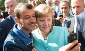 Angela Merkel has a selfie taken with a refugee during a visit to a refugee reception centre in Berlin last September.
