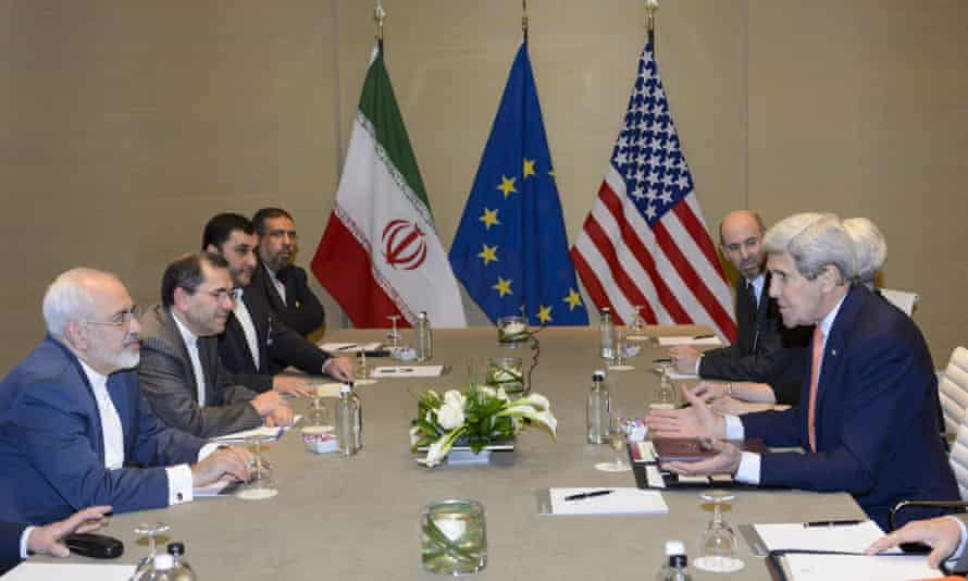 John Kerry, right, speaks with Iranian foreign minister Mohammad Javad Zarif, left