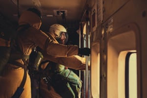 A smokejumper prepares to leap from a plane in Redmond, Oregon. 'Communication, safety and precision were three things that were in high consistency that day'