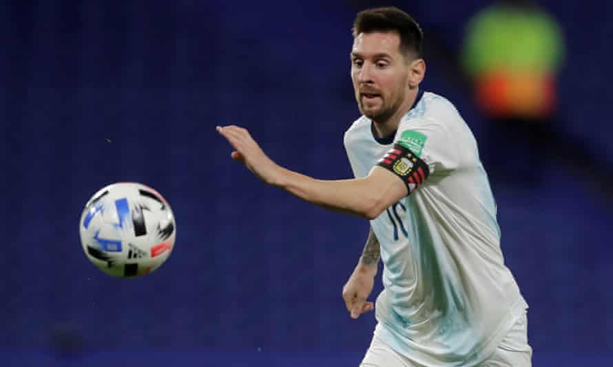 Argentina's Lionel Messi watched the ball which is in mid-air in front of him