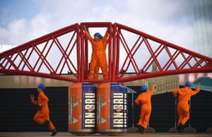 Dancers perform on a replica of the Forth Rail bridge during the Opening Ceremony for the Glasgow 2014 Commonwealth Games