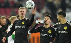 Erling Braut Haaland holds the match ball after his debut hat-trick for Dortmund at Augsburg.