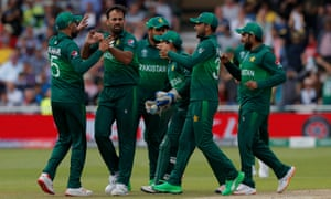 Pakistan's Wahab Riaz (2nd left) celebrates with teammates after taking the wicket of England's Jonny Bairstow.