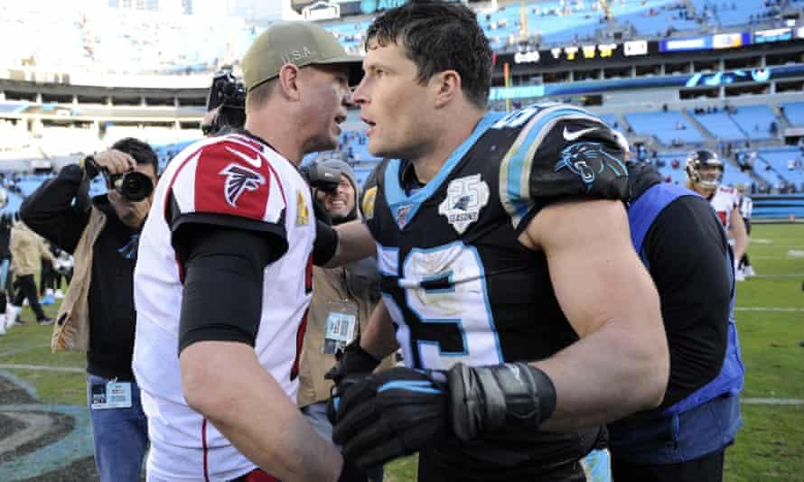 Luke Kuechly (59) greets Falcons quarterback Matt Ryan after a game earlier this season