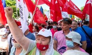 Supporters of socialists and communists protest in front of the Supreme Court of Justice in Chisinau, Moldova, yesterday.