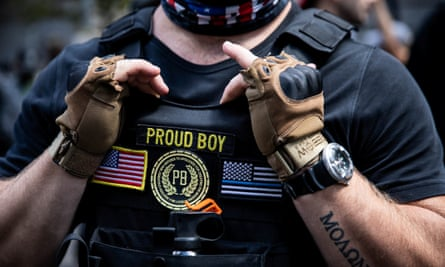 Members of the Proud Boys group participate in a 22 August protest in Portland, Oregon.
