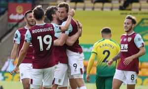 Chris Wood of Burnley is congratulated by his teammates after scoring.