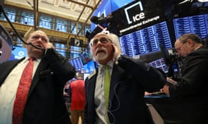 Traders work on the floor of the New York Stock Exchange on 22 January.