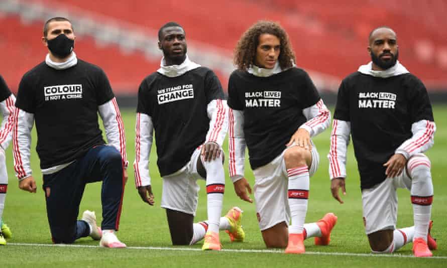 Arsenal's Sead Kolasinac, Nicolas Pépé, Matteo Guendouzi and Alexandre Lacazette take a knee before a friendly against Brentford on Wednesday.