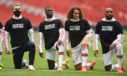 Arsenal's Sead Kolasinac, Nicolas Pépé, Matteo Guendouzi and Alexandre Lacazette take a knee before a friendly against Brentford on Wednesday.