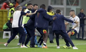 Lecce's Marco Calderoni (right) celebrates his goal with the bench.