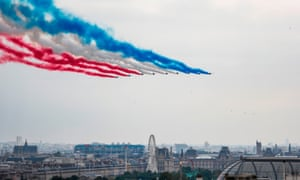 The French national acrobatic flying team over Paris during the annual Bastille Day military parade.