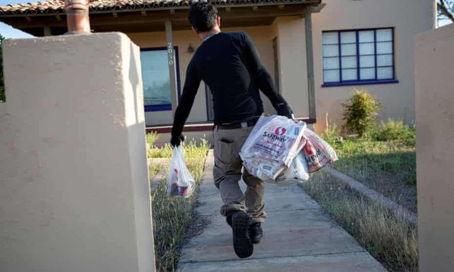 An Instacart worker delivers groceries in Tucson, Arizona, in 2020.