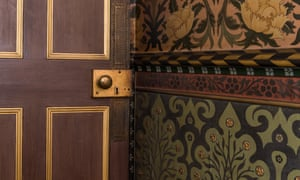 A gilded door and hand-painted walls