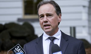 Greg Hunt speaks to the media during a press conference