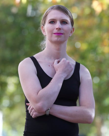 Chelsea Manning poses with a hand on her breast