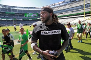 Running back Jay Ajayi, like several other Miami Dolphins players, wears a t-shirt in support of Colin Kaepernick before facing the New York Jets in New Jersey.