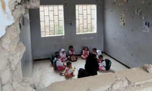 Children attend class at a bomb-damaged school in the port city of Hodeidah