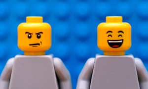 Tambov, Russian Federation - July 24, 2016 Two Lego minifigures - one strict and one happy. Blue background. Studio shot.GJ25FD Tambov, Russian Federation - July 24, 2016 Two Lego minifigures - one strict and one happy. Blue background. Studio shot.