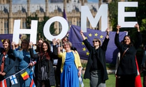 Protesters hold banners during a rally to lobby MPs to guarantee the rights of EU citizens living in the UK.