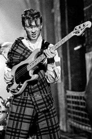Martin Kemp wearing a Highland sash while performing at the London Dungeon during the filming of the video for their first single, 'To Cut a Long Story Short', in 1980.