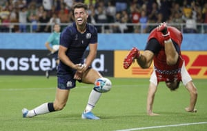 Scotland's Adam Hastings, left, reacts as Russia's German Davydov falls over after his last minute try was disallowed.