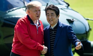 Japan's Prime Minister Shinzo Abe greets US President Donald Trump before playing a round of golf at Mobara Country Club in Chiba
